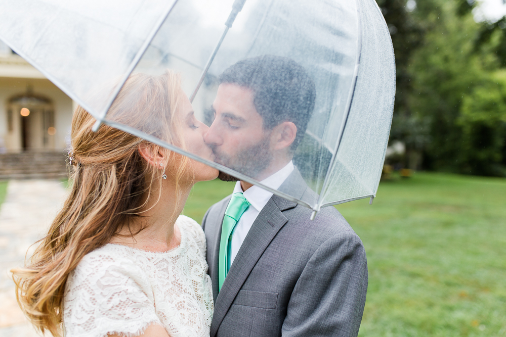 Wedding kiss in the rain