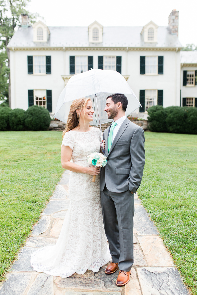 Happy couple in front of their wedding venue | Rust Manor House wedding photos