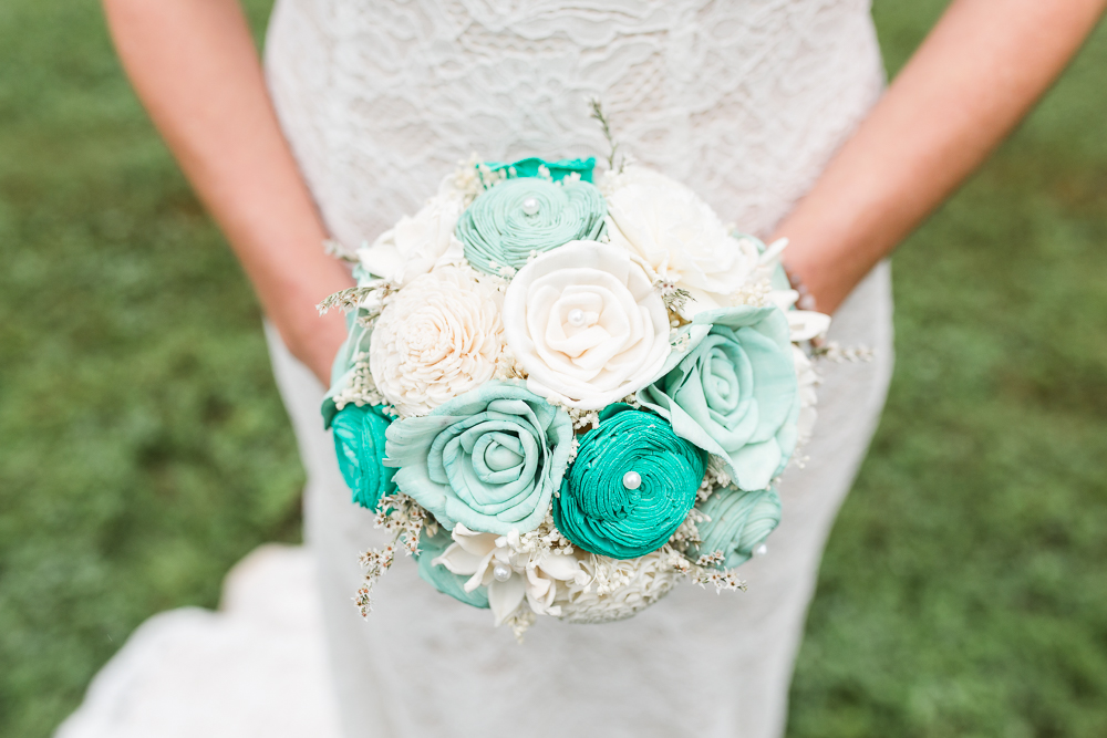 Teal and white wedding bouquet made of eco-friendly sola wood flowers