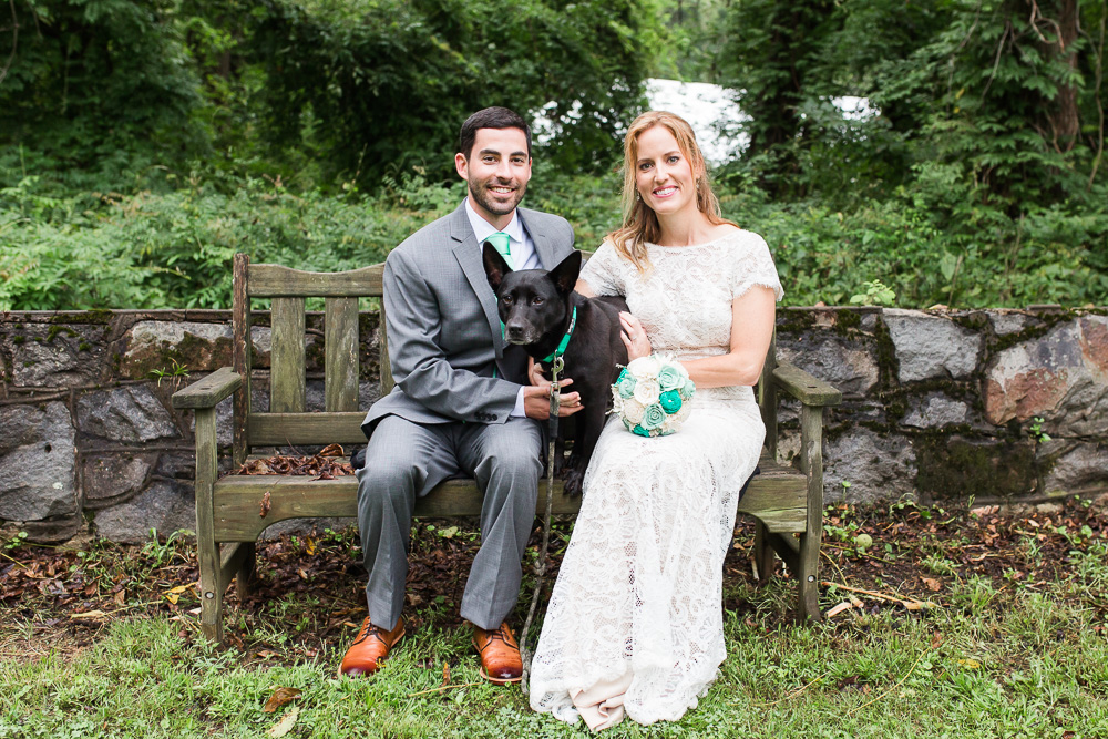 Bride and groom with their dog in the Rust Manor House garden