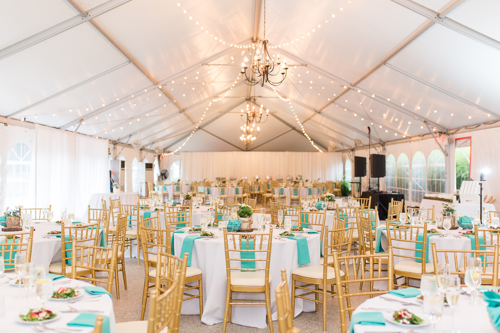 Teal wedding decor in reception tent at Rust Manor House
