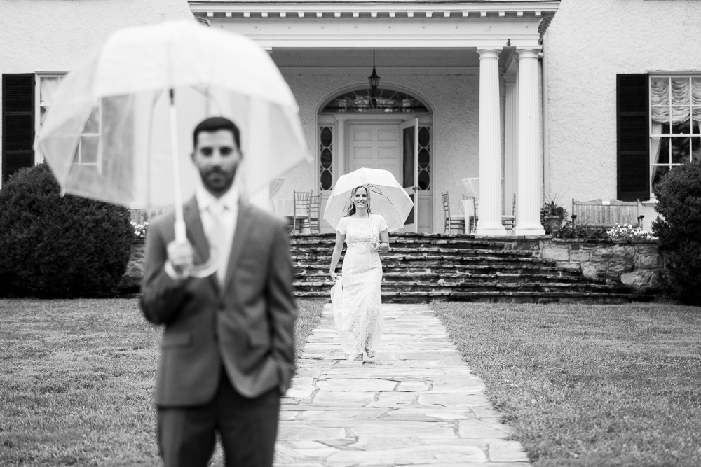 Bride walking to the groom for their First Look at Rust Manor House
