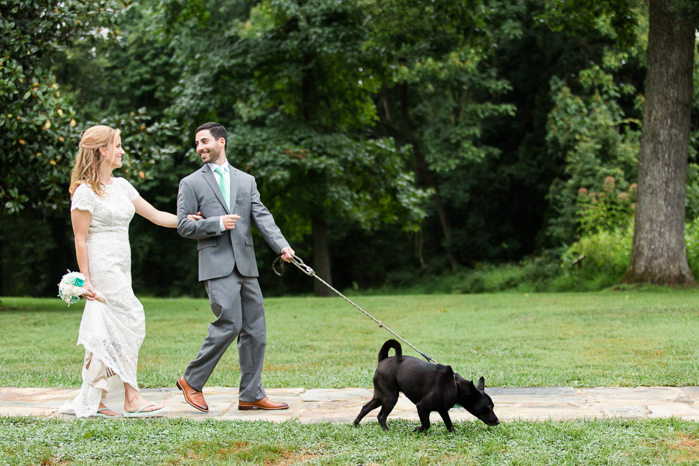 Walking their dog on their wedding day
