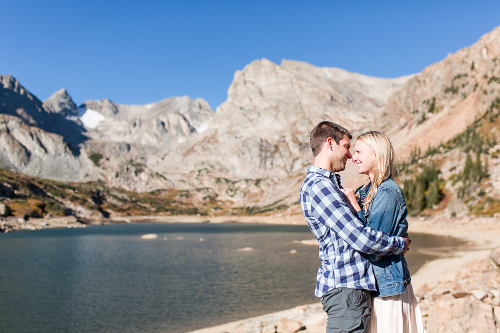 Engaged couple keeping warm during a chilly fall hike on the Pawnee Pass Trail to Lake Isabelle