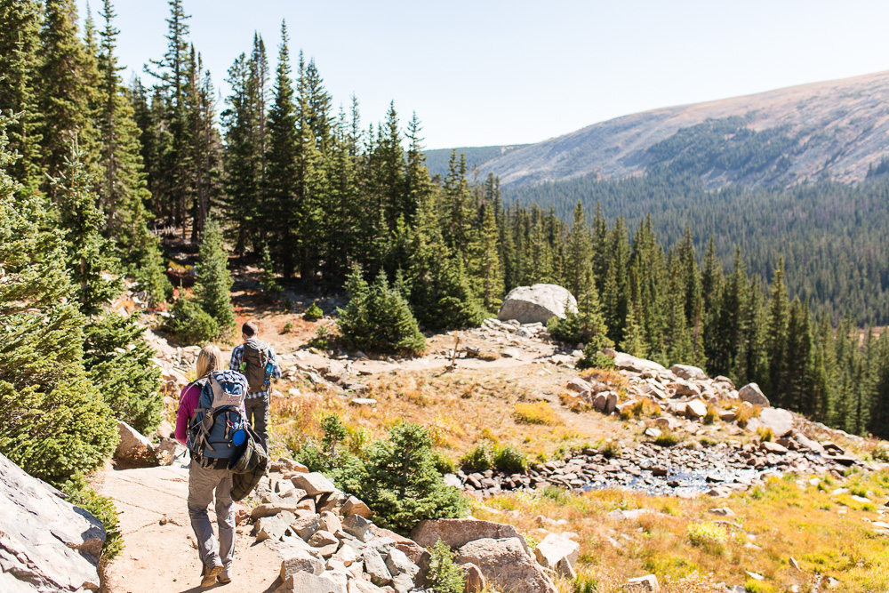 Hiking engagement photographer in Colorado   Indian Peaks Wilderness hike   Megan Rei Photography