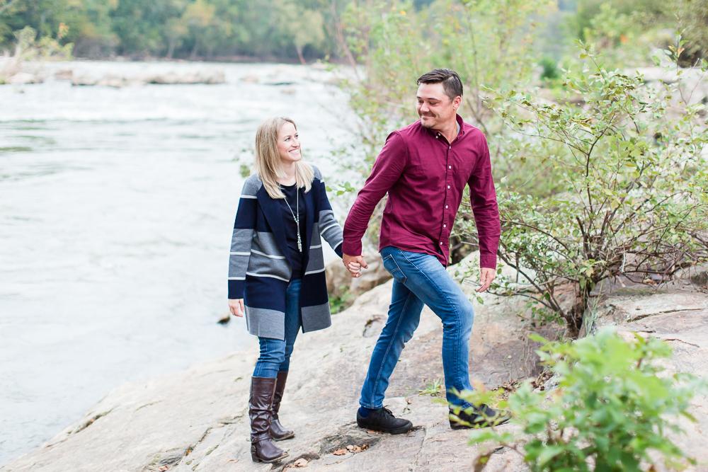 Walking along the river in Fredericksburg, Virginia for engagement photos