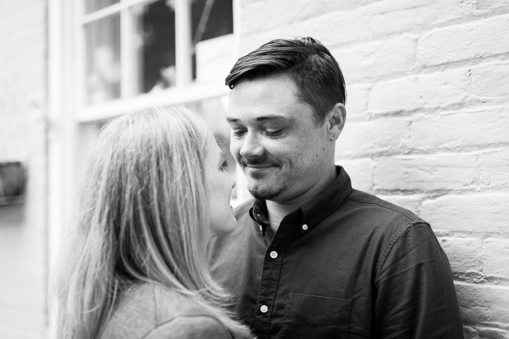 Romantic black and white engagement picture in downtown Fredericksburg