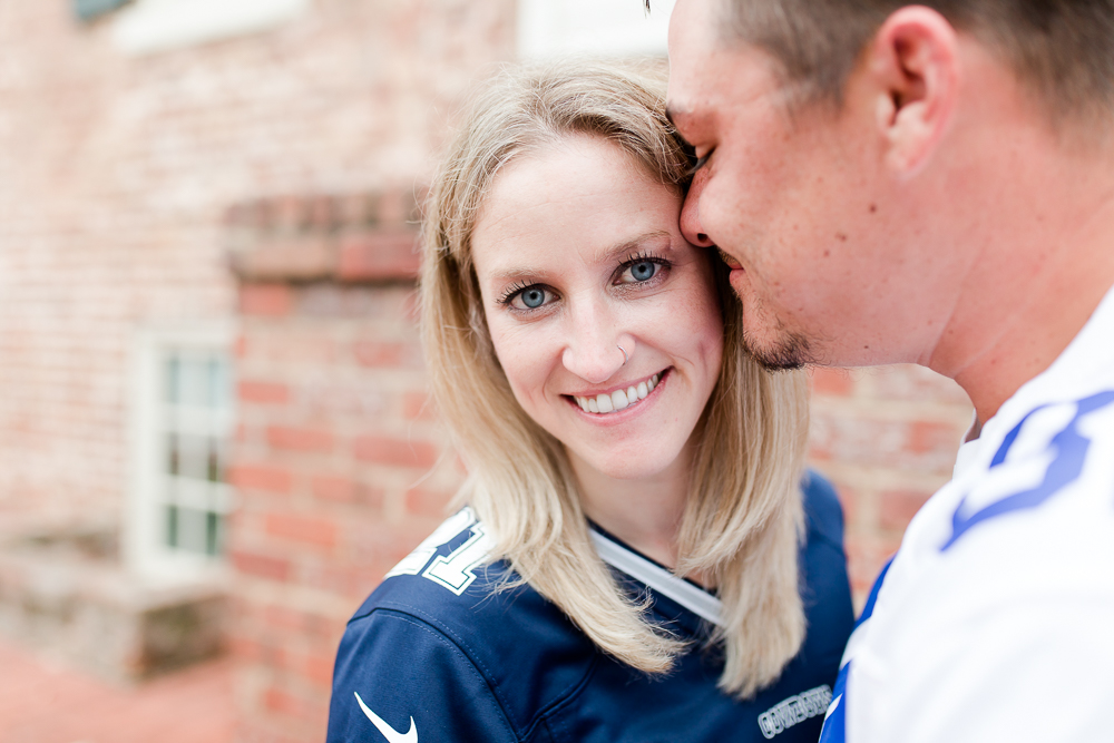 Smiling at the camera during an engagement session in downtown Fredericksburg | Northern Virginia engagement photography