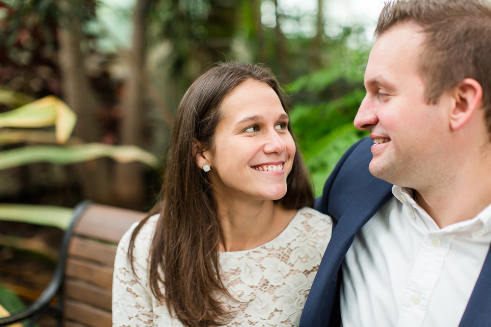 Sitting on a bench in the gardens | Buffalo engagement session