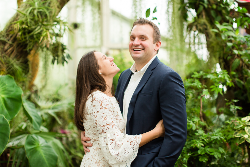 Laughing during their engagement pictures at Buffalo Botanical Gardens | Candid Buffalo Photographer