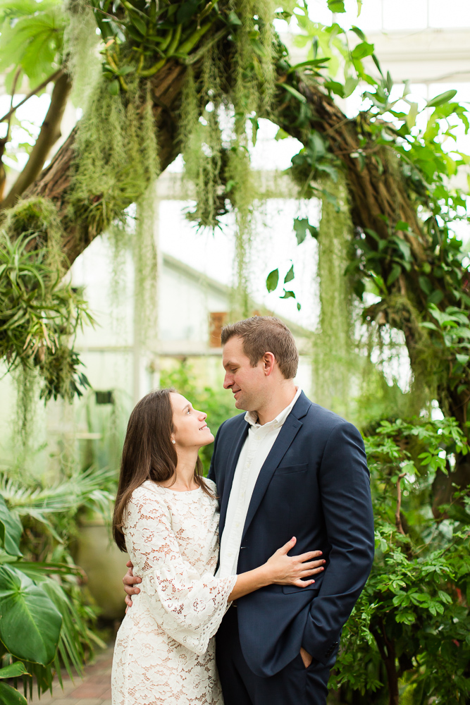 Engagement pictures under the trees at the botanical gardens in Buffalo, NY