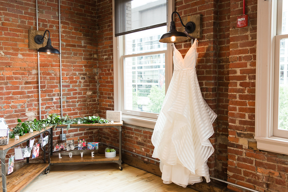Hayley Paige Decklyn wedding dress from Lovely Bride hanging at the Loft at 600 F in Washington, DC