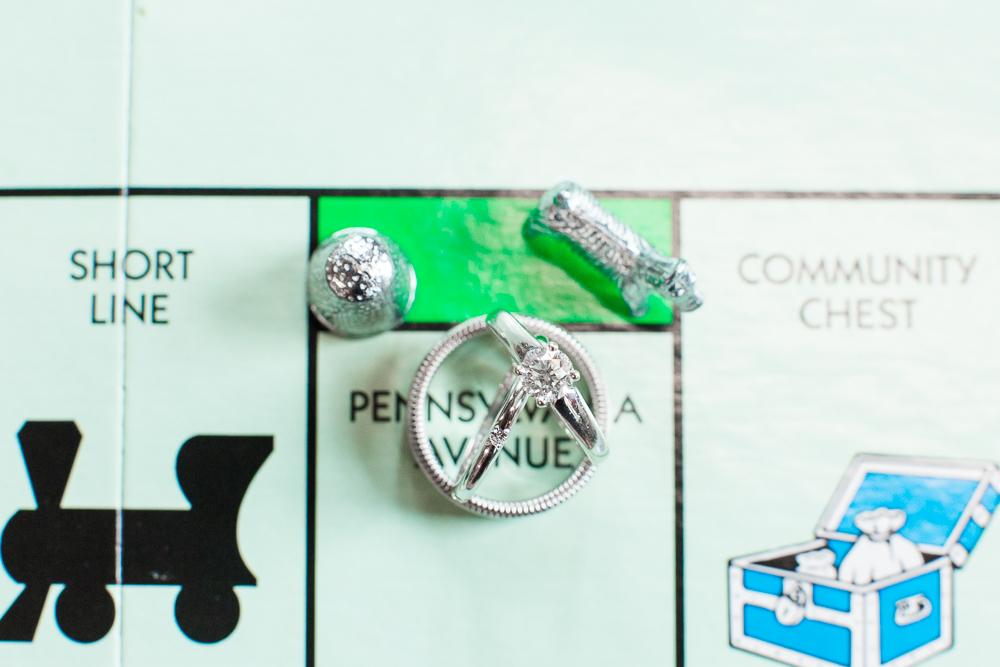 Wedding rings on Monopoly board | Monopoly wedding ideas