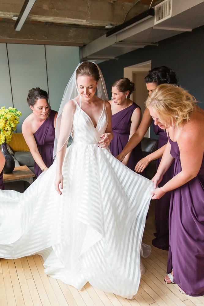 Bride putting on her Hayley Paige Decklyn wedding dress | Loft at 600 F Wedding in Washington, DC