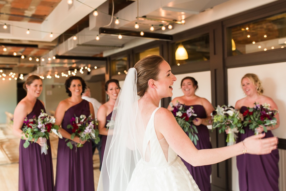 Candid moment of bride and her bridesmaids having fun