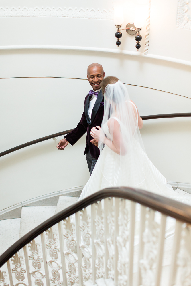 Bride and groom first look on the staircase at Hotel Monaco in DC