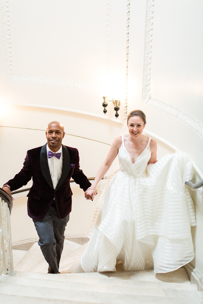 Wedding couple walking up the spiral staircase at the Kimpton Hotel Monaco in DC