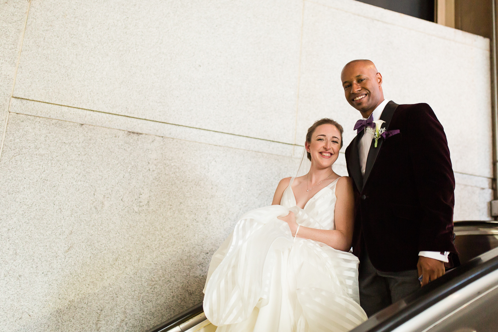Bride and groom riding the escalator down into the DC Metro