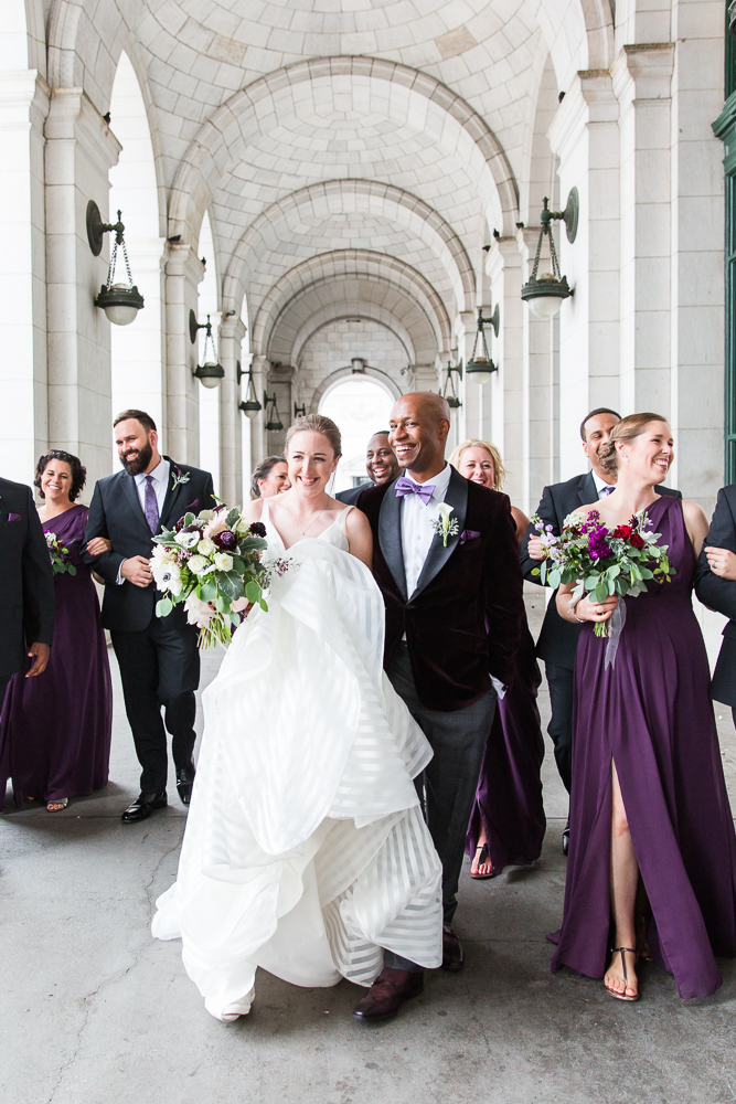 Candid wedding photo of bridal party walking at Union Station | Best candid DC wedding photography