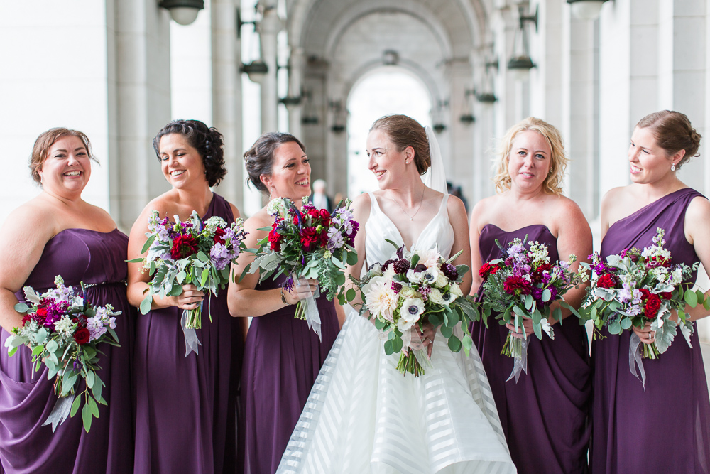 Candid photo of bride and her bridesmaids in purple dresses | Candid DC wedding photographer