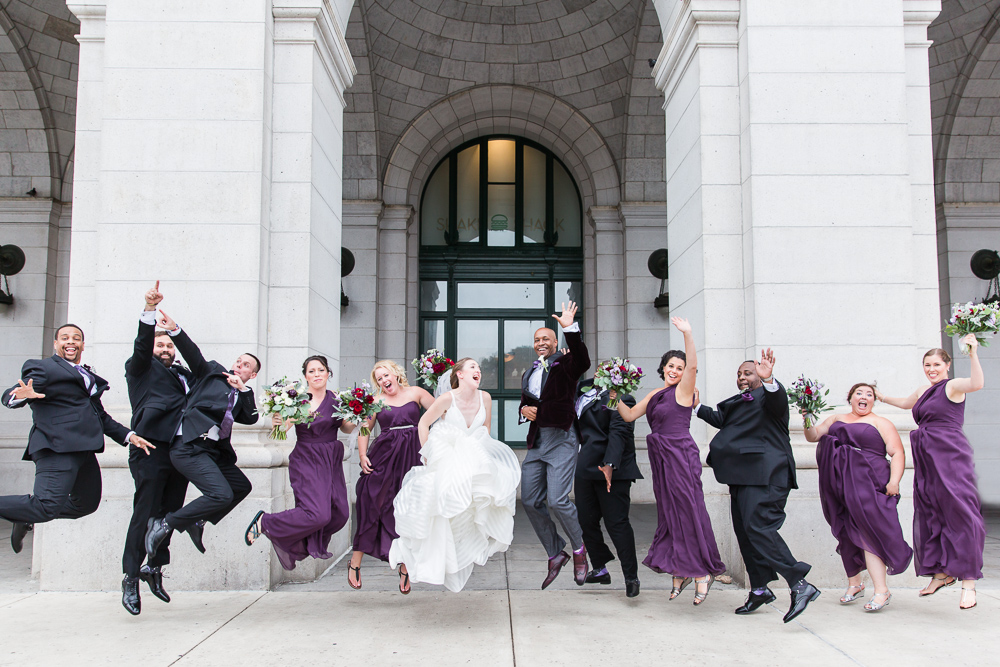 Fun wedding picture of whole wedding party jumping outside of Union Station | Fun DC wedding photography