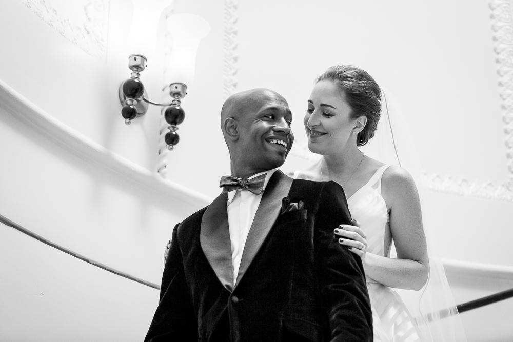 Bride and groom first look on the stairs at the Kimpton Hotel Monaco in DC