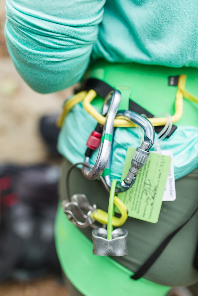 Close up photo of carabiners and other rock climbing gear during adventure engagement shoot