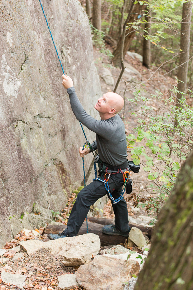 Belaying his fiance as she climbs the face of Seneca Rocks in West Virginia