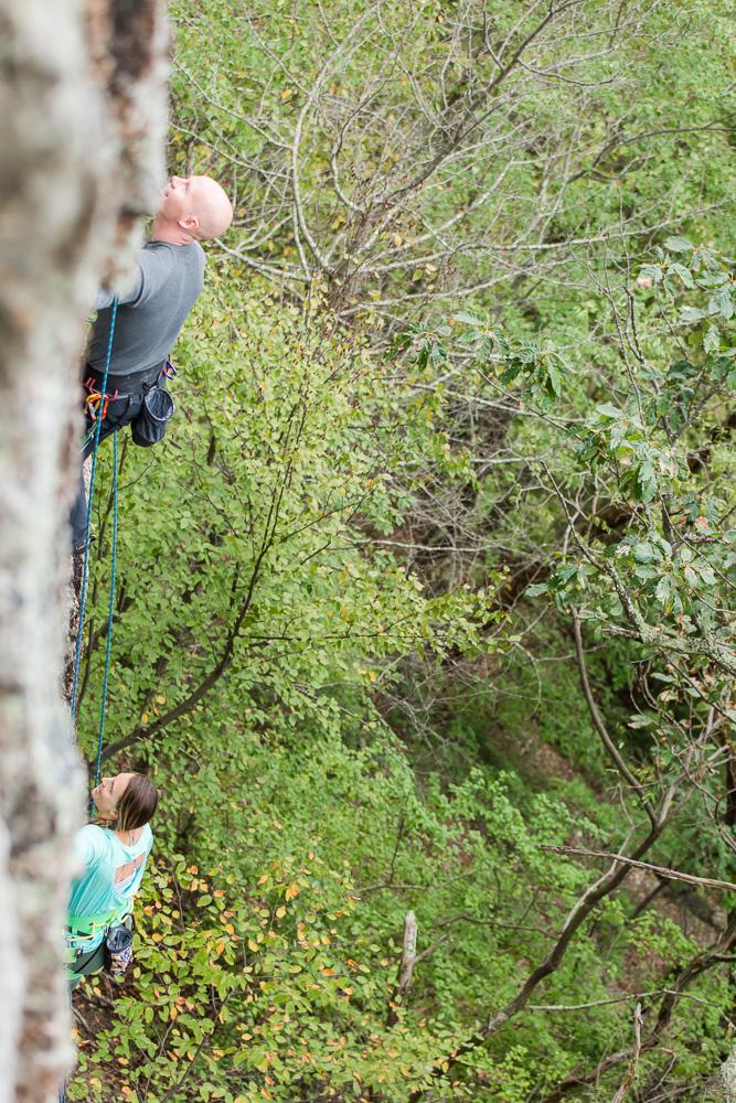 Engaged couple rock climbing at Seneca Rocks | Engagement photo ideas for rock climbers