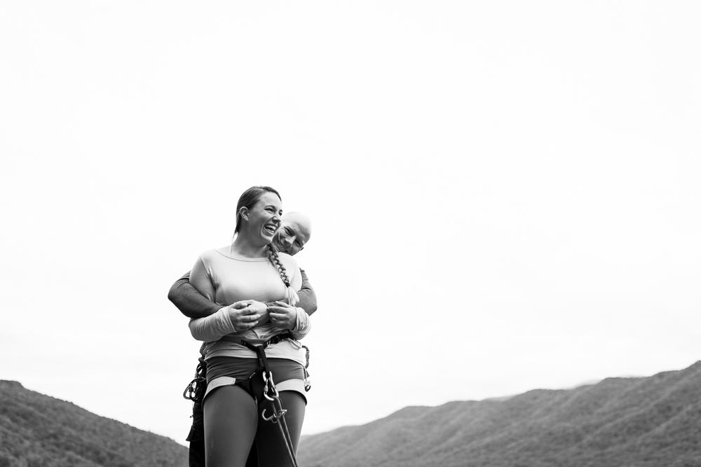 Standing on top of Seneca Rocks during a rock climbing engagement shoot | Northern Virginia adventure engagement photography