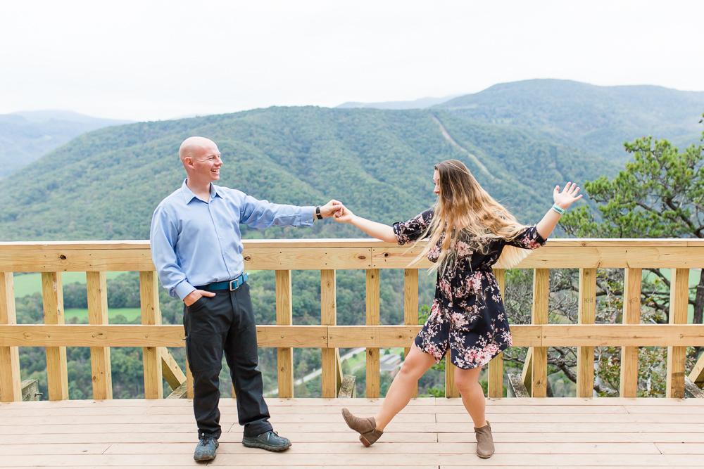 Dancing at the overlook at Seneca Rocks | Fun engagement photography