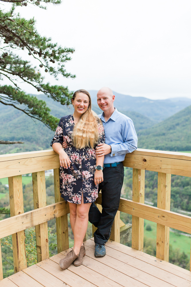 Mountain lovers engagement pictures, taken at the Seneca Rocks overlook after a rock climbing session