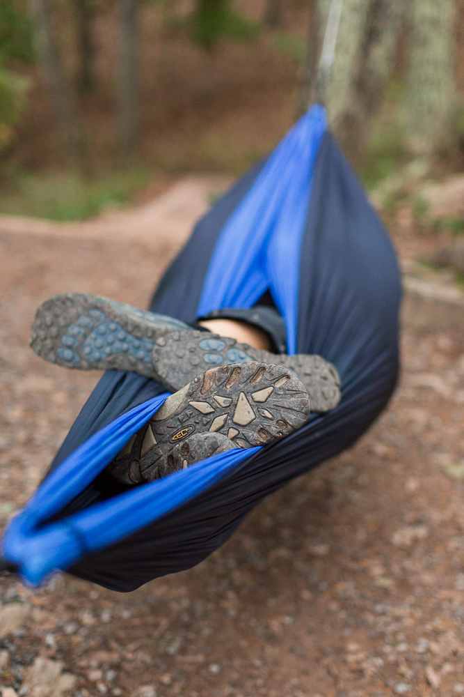 Hiking boots sticking out of hammock | Funny ideas for camping engagement shoot