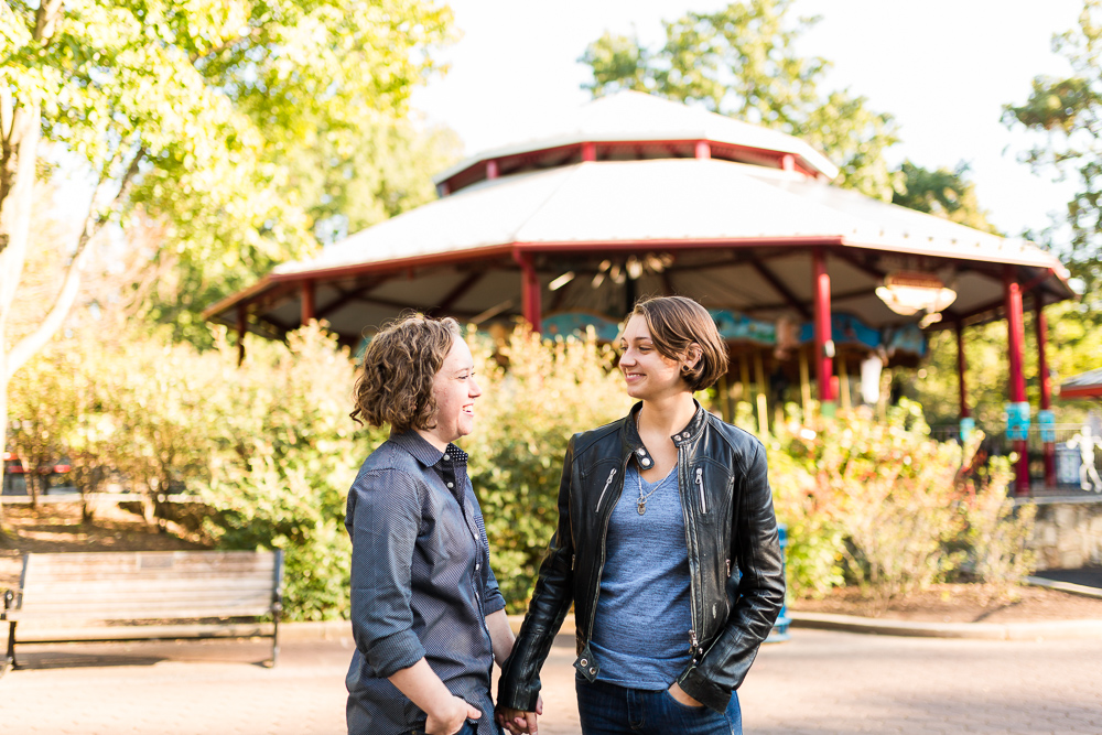 Engagement picture in front of the carousel at the zoo | Washington DC Engagement Photographer