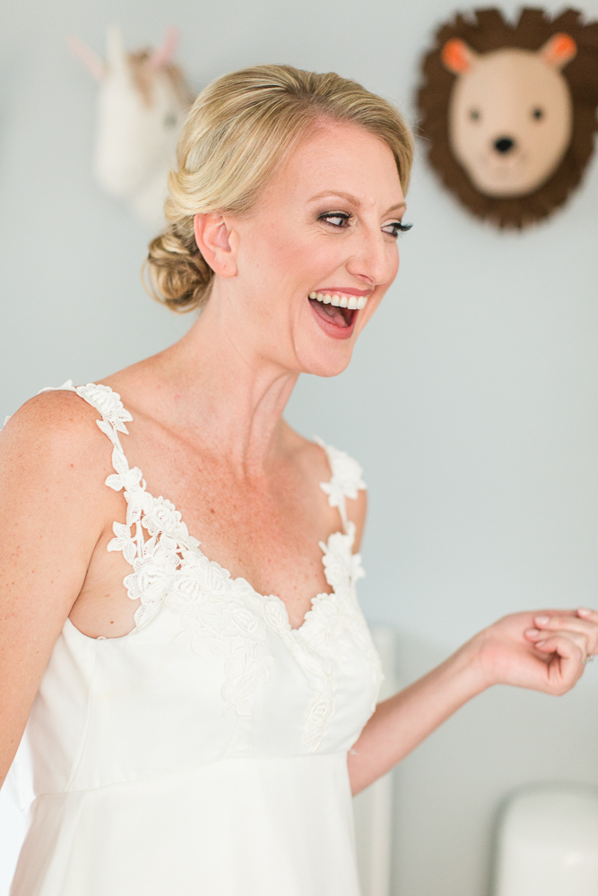 Happy bride showing off her wedding dress to her mom | Dress alterations by The Wedding Seamstress, Denver, Colorado