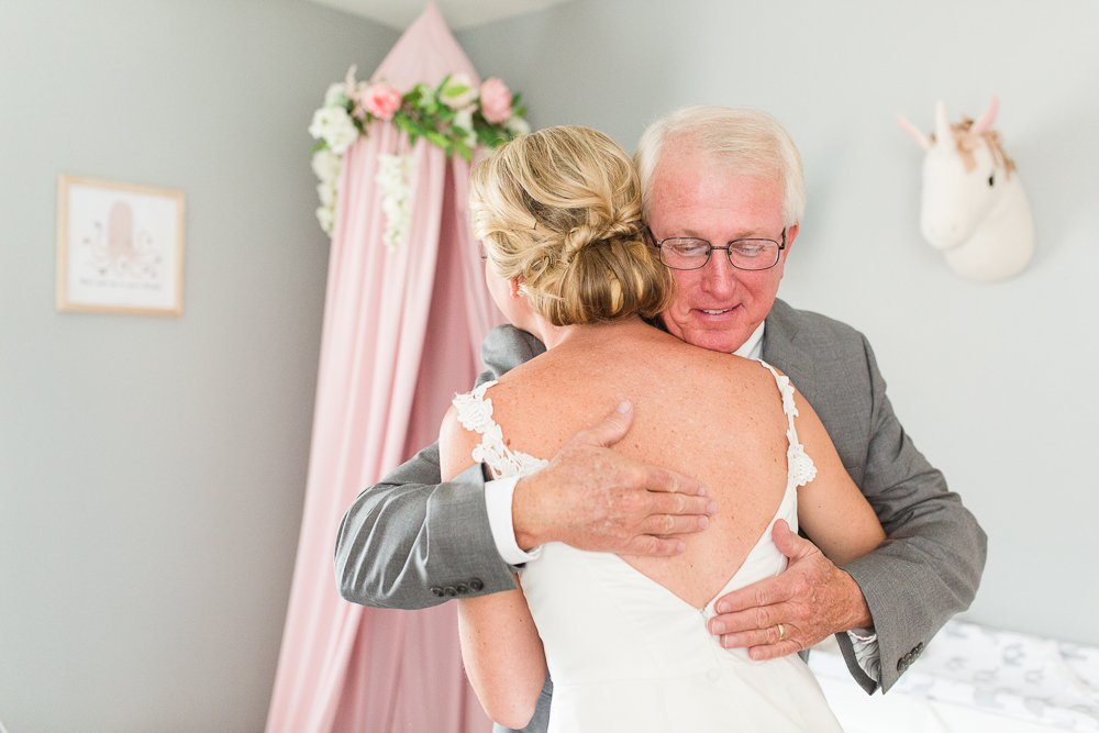 Bride hugging her dad after their first look