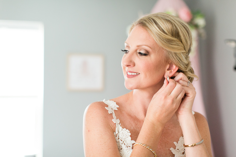 Denver bride putting on her earrings the morning of her wedding day | Denver wedding