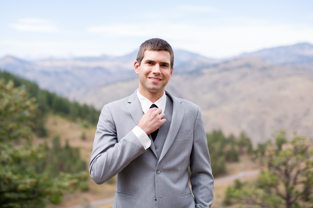 Groom posing at the top of Lookout Mountain