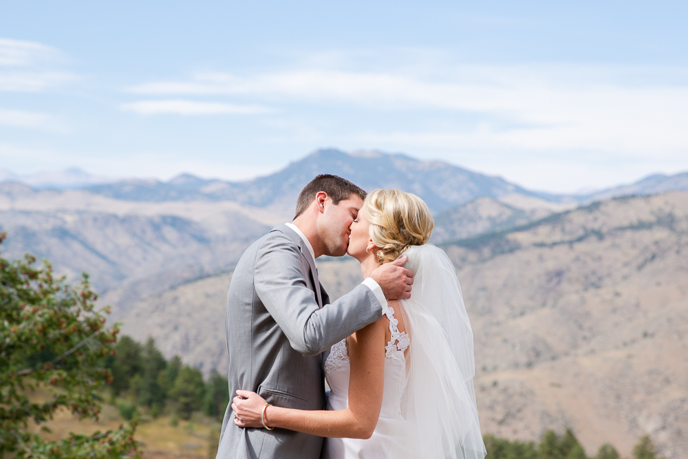 Bride and groom kiss in the mountains of Golden, Colorado | Colorado Wedding Photography