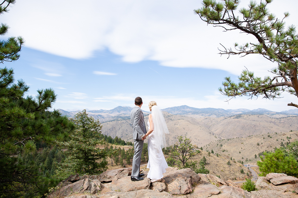 Wedding couple looks off at the mountains from Lookout Mountain in Golden, Colorado | Best spots for wedding pictures in Colorado