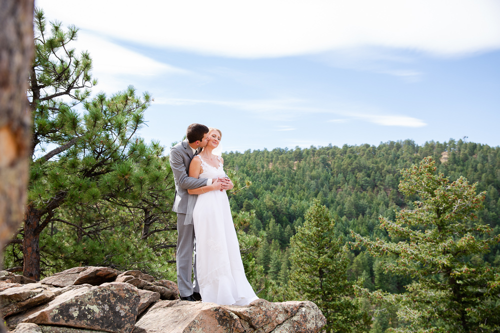 Groom kissing the bride at the overlook of Lookout Mountain
