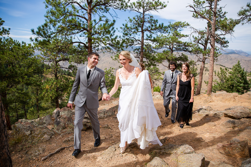 Bride and groom walking with their bridal party on the trail at Lookout Mountain | Golden, CO Wedding Photographer