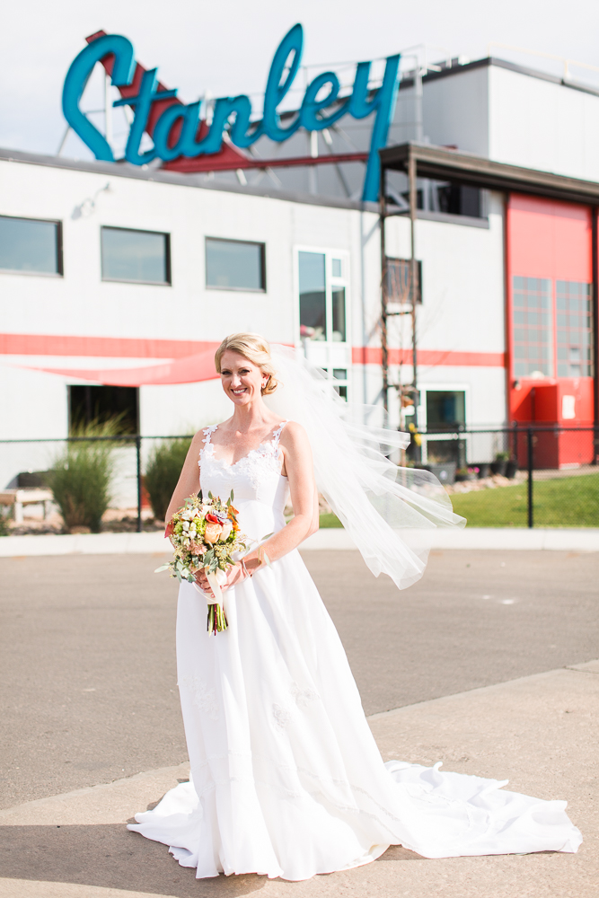 Bride posing in front of the Stanley sign at Stanley Marketplace
