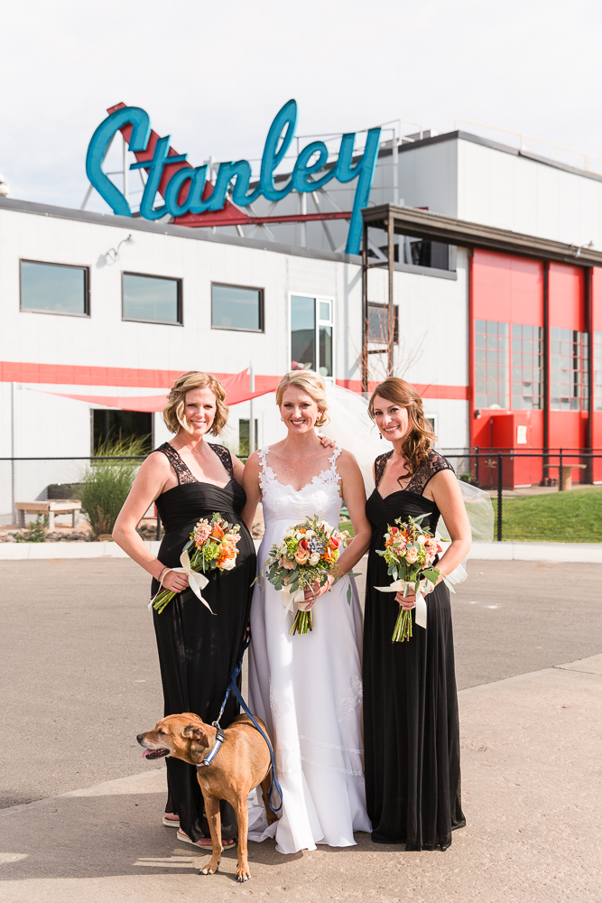 Bride, bridesmaids, and dog at The Hangar at Stanley Marketplace | Colorado Wedding