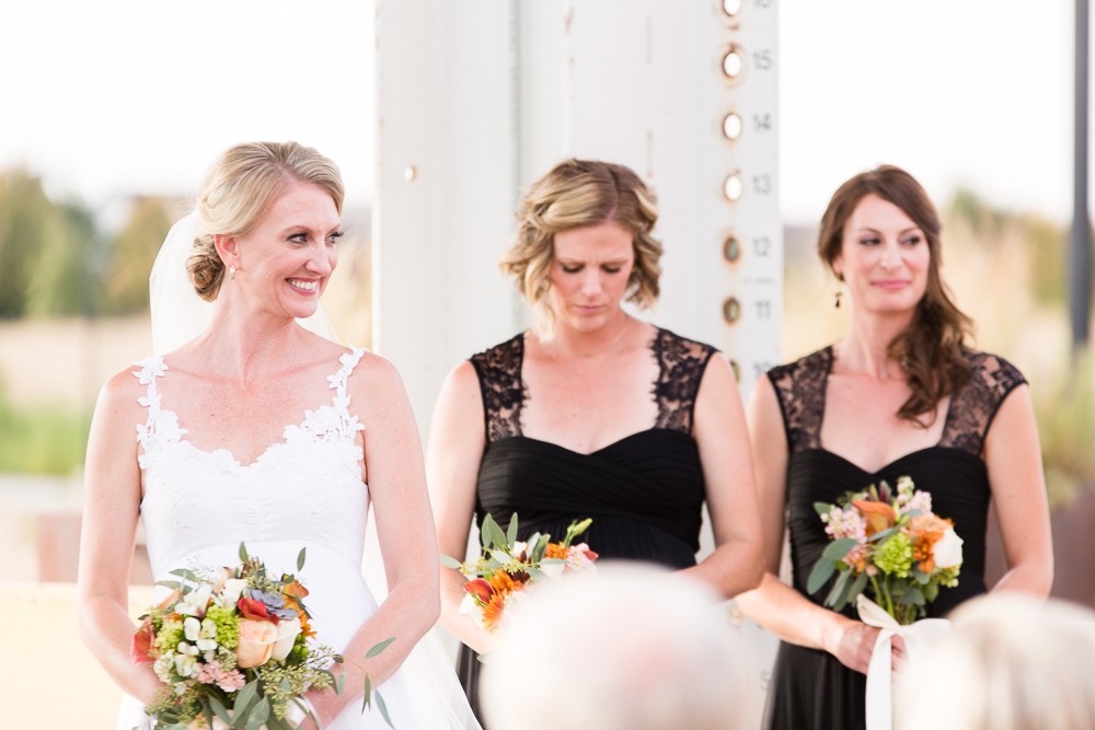 Bride and bridesmaids during the ceremony | Aurora, CO Wedding Photography