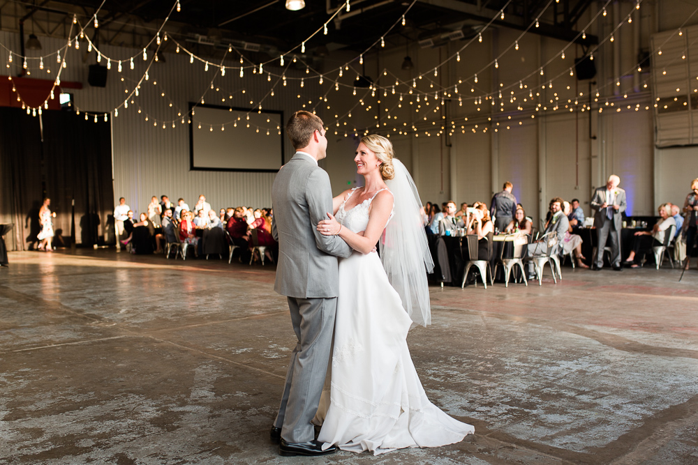 Bride and groom having their first dance at their wedding in the Hangar at Stanley Marketplace | Denver Colorado Wedding Photographer