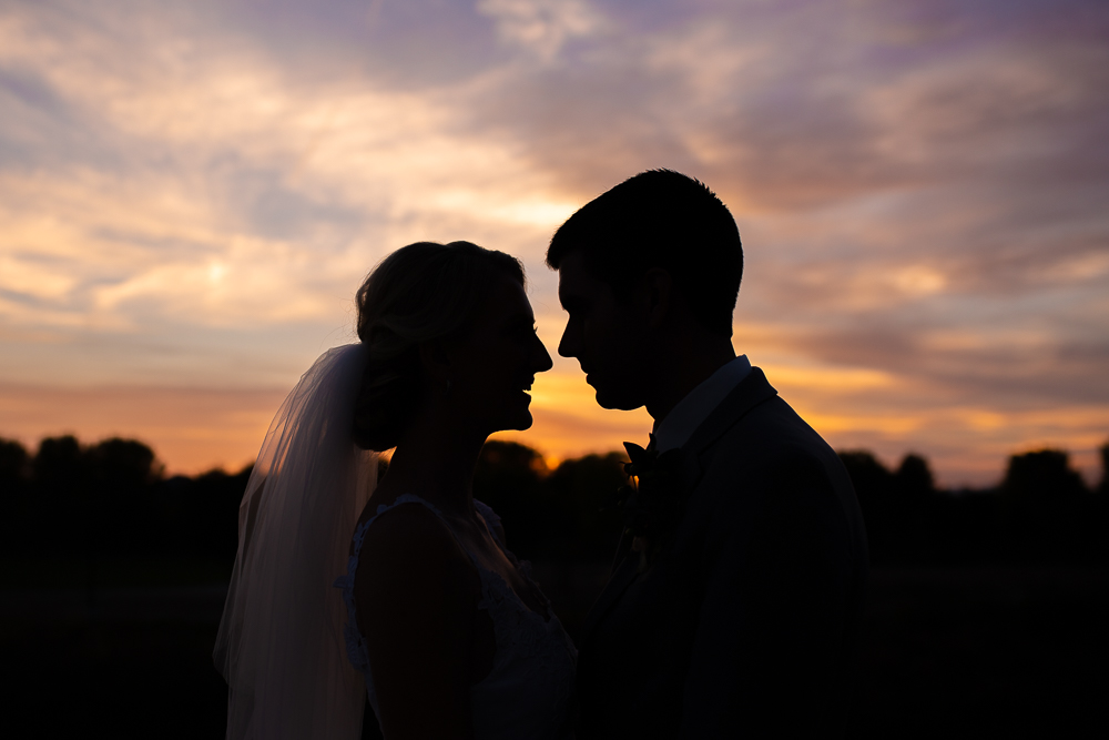 Beautiful sunset wedding picture outside of Stanley Marketplace | Best Denver, Colorado wedding pictures