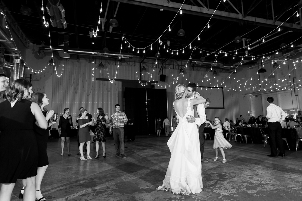 Husband and wife dancing at The Hangar at Stanley Marketplace | Best Aurora, CO wedding venues