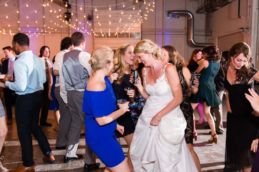 Bride and wedding guests having fun on the dance floor during Aurora, CO wedding