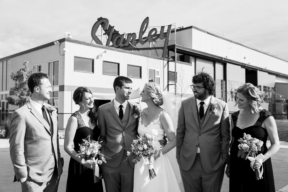 Black and white wedding party photo at Stanley Marketplace in Aurora, CO